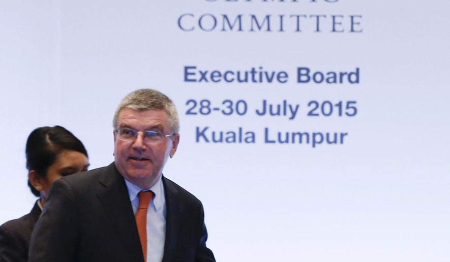 President of the International Olympic Committee (IOC) Thomas Bach arrives for IOC Executive board meeting in Kuala Lumpur, Malaysia,Tuesday, July, 28, 2015. Malaysia is hosting the 128th International Olympic Committee executive board meeting where the vote for the host cities of the 2022 Olympic Winter Games and for the 2020 Youth Olympic Winter Games will take place. (AP Photo/Vincent Thian)