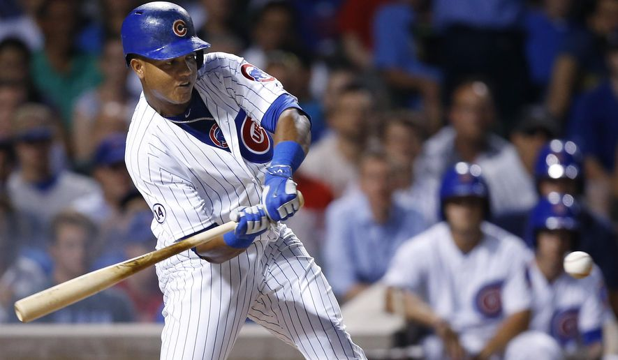 Chicago Cubs' Starlin Castro hits a two-RBI single against the Colorado Rockies during the fourth inning of a baseball game in Chicago, Monday, July 27, 2015. (AP Photo/Andrew A. Nelles)