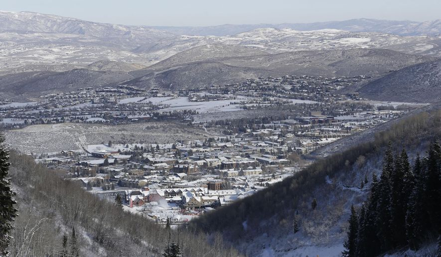 FILE - This Nov. 23, 2013, file photo, shows Park City from a trail at the Park City Mountain Resort, in Park City, Utah. Ski industry titan Vail Resorts is set to make official Wednesday, July 29, 2015, that it is combining Canyons Resort and Park City Mountain Resort under one name and logo. That will make it one of the largest ski areas in North America once a connecting lift is completed. (AP Photo/Rick Bowmer, File)