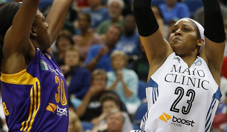 Minnesota Lynx forward Maya Moore (23) shoots against Los Angeles Sparks forward Nneka Ogwumike (30) during the first half of a WNBA basketball game, Wednesday, July 29, 2015, in Minneapolis. (AP Photo/Stacy Bengs)