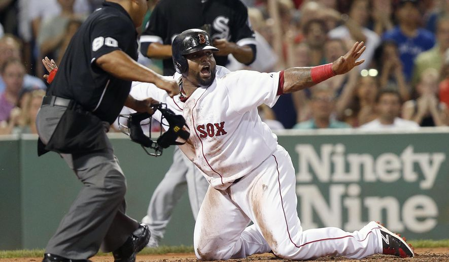 Boston Red Sox's Pablo Sandoval, right, gestures safe as home plate umpire Adrian Johnson makes the call after Sandoval was thrown out at home on a double by Ryan Hanigan during the third inning of a baseball game against the Chicago White Sox in Boston, Wednesday, July 29, 2015. (AP Photo/Michael Dwyer)