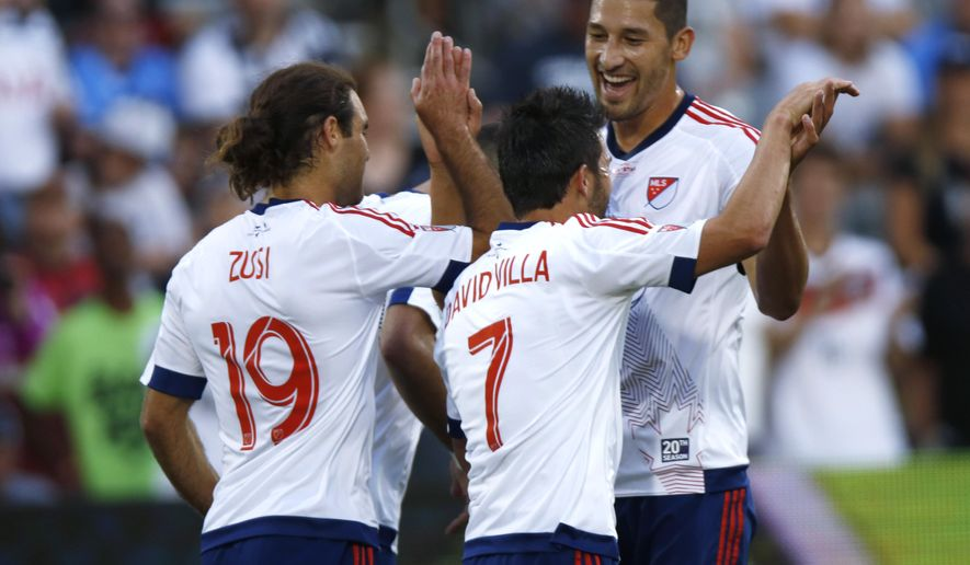 MLS All-Star forward David Villa, center, celebrates scoring a goal with teammates Graham Zusi, left, and Omar Gonzalez, right, against Tottenham Hotspur during the first half of the MLS All-Star soccer game, Wednesday, July 29, 2015, in Commerce City, Colo. The game is the 20th annual mid-season classic for the league. (AP Photo/David Zalubowski)