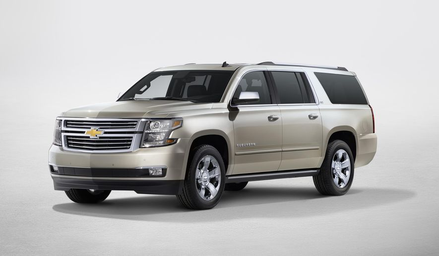This product image provided by General Motors shows a 2015 Chevrolet Suburban. The expansive, 19-foot-long Suburban is refreshed for 2015 with more engine power, best-in-class fuel economy, more features than ever, a surprisingly quiet interior and more comfortable seats _ large, of course. (General Motors via AP)