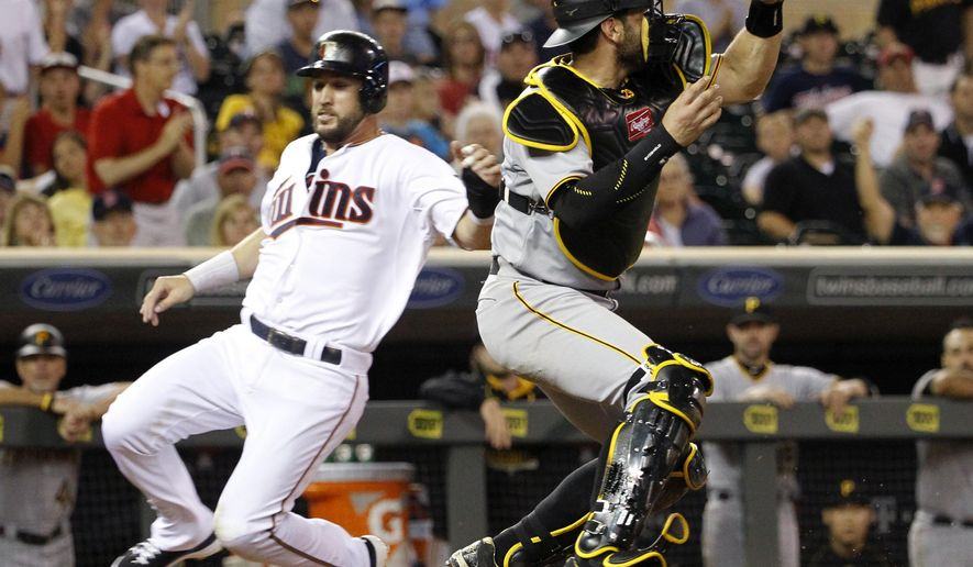Minnesota Twins' Trevor Plouffe, left, beats the throw from left field to Pittsburgh Pirates catcher Francisco Cervelli, right, to score on a single by the Twins' Aaron Hicks during the eighth inning of a baseball game in Minneapolis, Tuesday, July 28, 2015. The Pirates won 8-7. (AP Photo/Ann Heisenfelt)