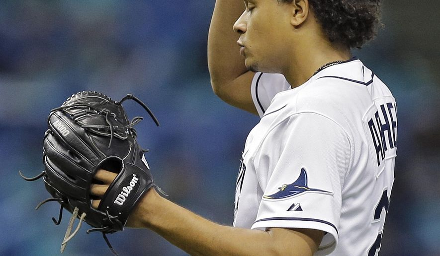 Tampa Bay Rays starting pitcher Chris Archer reacts after giving up two runs to the Detroit Tigers during the seventh inning of a baseball game Wednesday, July 29, 2015, in St. Petersburg, Fla.  The Tigers won the game 2-1. (AP Photo/Chris O'Meara)