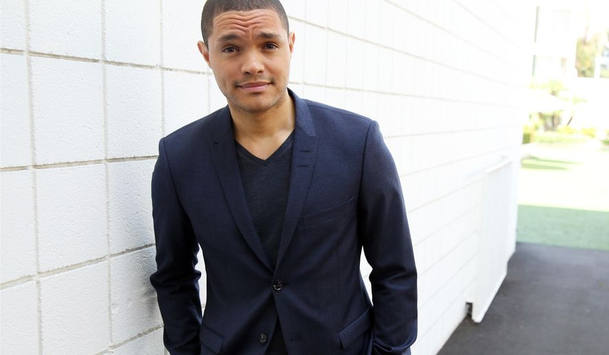 "Trevor Noah poses for a portrait at The Beverly Hilton in Beverly Hills, Calif., Wednesday, July 29, 2015. Noah said politics and the media will remain targets of the program he will inherit from Jon Stewart but the perspective will be distinctively his. ""The show still has its voice. It's just I'm at the helm taking things in a slightly different direction, but still trying to get to the same end place,"" Noah said Wednesday during a Q&A session with TV critics. (Photo by Matt Sayles/Invision/AP)"