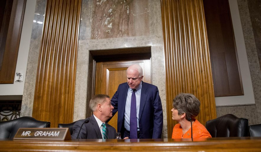Senate Armed Services Committee Chairman Sen. John McCain, R-Ariz., center, talks with committee members Sen. Lindsey Graham, R-S.C., and Sen. Joni Ernst, R-Iowa, on Capitol Hill in Washington, Wednesday, July 29, 2015, prior to the committee's hearing on the impacts of the Joint Comprehensive Plan of Action (JCPOA) on U.S. Interests and the Military Balance in the Middle East. (AP Photo/Andrew Harnik)