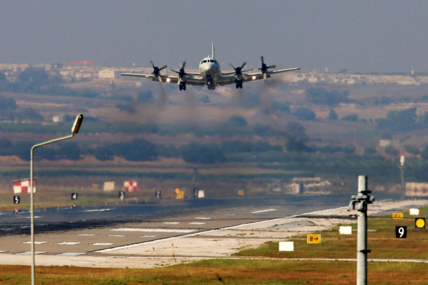 A U.S. Navy plane lands at the Incirlik Air Base near Adana, Turkey, on Wednesday. Turkey agreed to allow the U.S.-led coalition to launch airstrikes against Islamic State from the base but now Egypt is accusing Turkey of working with the Islamic State on the Sinai Peninsula, a bitter feud likely complicate the Obama administration's regional plans. (Associated Press)