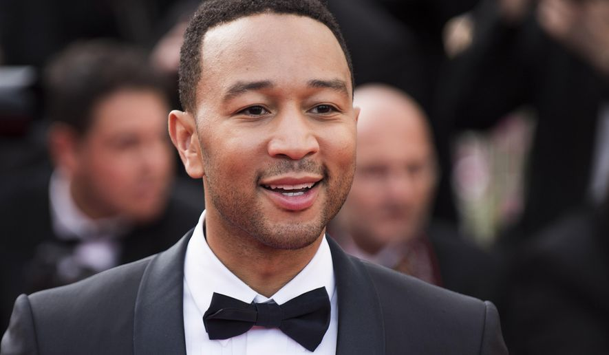 "FILE - In this May 13, 2015 file photo, John Legend arrives for the opening ceremony and the screening of the film ""La Tete Haute"" (Standing Tall), at the 68th international film festival, Cannes, southern France. Legend is bringing his talents to a TV drama about Southern slaves fighting for freedom. WGN America said Wednesday, July 29, 2015, that Legend and his production company will be in charge of the score and soundtrack for ""Underground.""  (Photo by Arthur Mola/Invision/AP, File)"