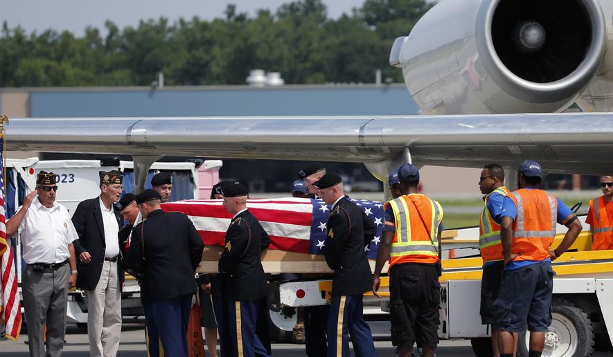 The remains of a World War II fighter pilot Lt. Edward F. Barker are transferred from a commercial airplane to a waiting hearse at Albany International Airport on Wednesday, July 29, 2015, in Colonie, N.Y. Barker was a 21-year-old Army Air Forces pilot when he failed to return from a training mission in Papua New Guinea in 1944. His remains were recovered in 2012 and will be transported to his hometown in Herkimer, N.Y., where a graveside service with full military honors will be held on Saturday. (AP Photo/Mike Groll)