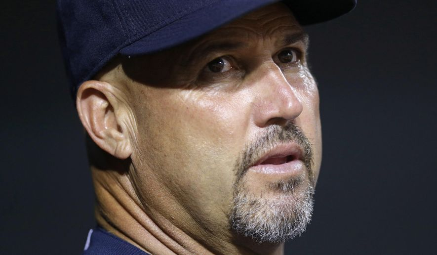 Atlanta Braves manager Fredi Gonzalez watches from the dugout in the fifth inning of an interleague baseball game against the Baltimore Orioles, Wednesday, July 29, 2015, in Baltimore. (AP Photo/Patrick Semansky)