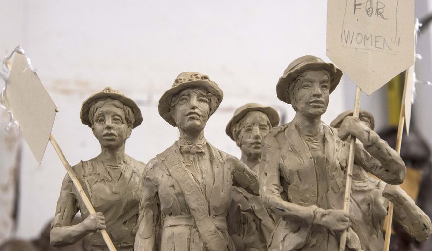 a smaller version of  a monument for women's suffrage that artist Alan LeQuire is working on is displayed on July 28, 2015 in Nashville, Tenn.  The sculpture being molded by LeQuire depicts five women who played critical roles in passing the 19th Amendment.  (John Partipilo/The Tennessean via AP) NO SALES; MANDATORY CREDIT