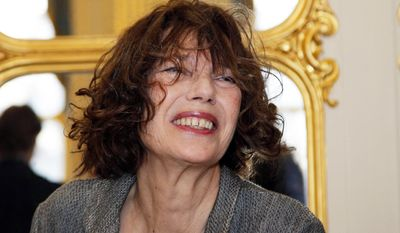 "In this April 10, 2013, file photo, actress and singer Jane Birkin attends a ceremony as her daughter Lou Doillon was awarded Officer in the Arts and Letters by French culture minister Aurelie Filippetti, at the Culture Ministry in Paris. Birkin has asked Hermes to take her name off the crocodile-skin versions of the iconic Birkin handbag, after being contacted by animal rights group PETA over ""cruel"" slaughtering practices. (AP Photo/Christophe Ena, File)"