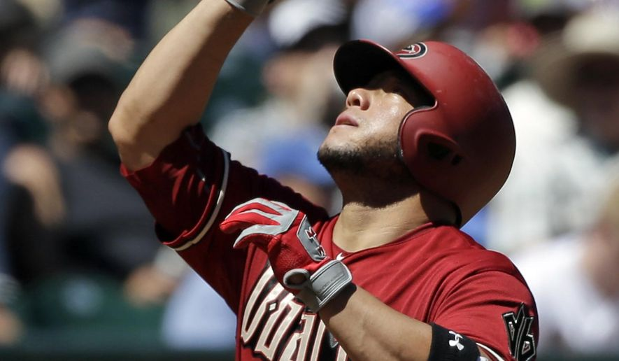 Arizona Diamondbacks' Welington Castillo points skyward as he heads in on his home run against the Seattle Mariners in the fourth inning of a baseball game Wednesday, July 29, 2015, in Seattle. (AP Photo/Elaine Thompson)