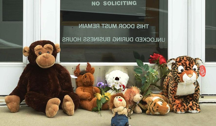 "Stuffed animals adorn the doorstep of Dr. Walter Palmer's River Bluff Dental office in Bloomington, Minn., Tuesday, July 28, 2015. Palmer, accused of illegally killing a protected lion in Zimbabwe, said Tuesday that he thought everything about his trip was legal and wasn't aware of the animal's status ""until the end of the hunt."" (Scott Takushi/Pioneer Press via AP)"