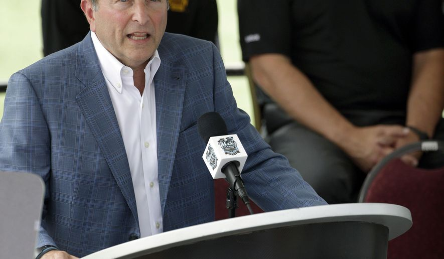 NHL Commissioner Gary Bettman speaks during an event at Gillette Stadium Wednesday, July 29, 2015, in Foxborough, Mass., to promote the NHL Winter Classic hockey game between the Montreal Canadiens and Boston Bruins, scheduled to be played there on New Year's day 2016. At rear are Bruins General Manager Don Sweeney, left, and Bruins President Cam Neely, right.  (AP Photo/Stephan Savoia)