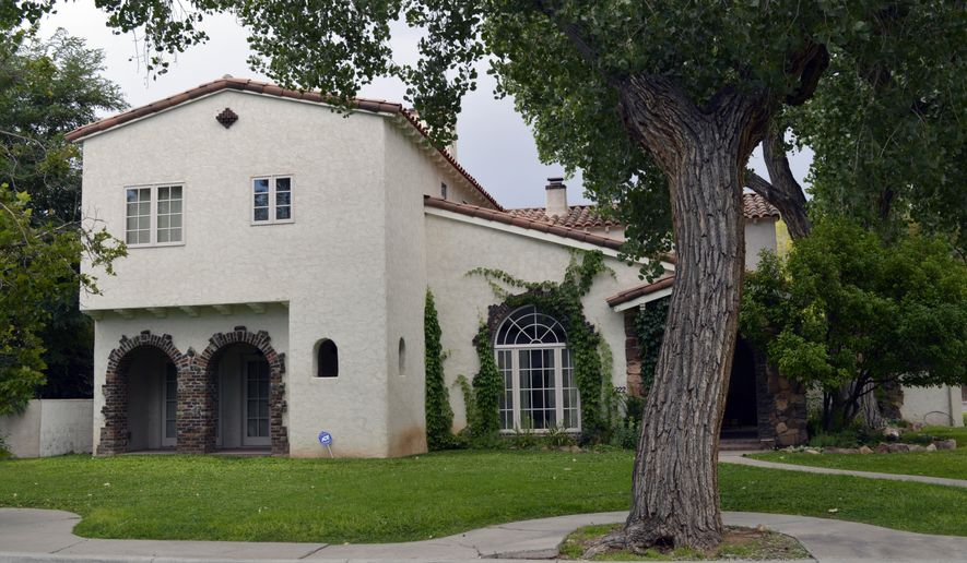 "This 3,500-square foot, 4-bedroom home in the Albuquerque's Country Club area that was used in AMC's TV series ""Breaking Bad"" is up for sale, Wednesday, July 29, 2015. A mother-daughter realty team said this week they are helping sell the home where the fictitious Jesse Pinkman, played by Aaron Paul, made methamphetamine. (AP Photo/Russell Contreras)"