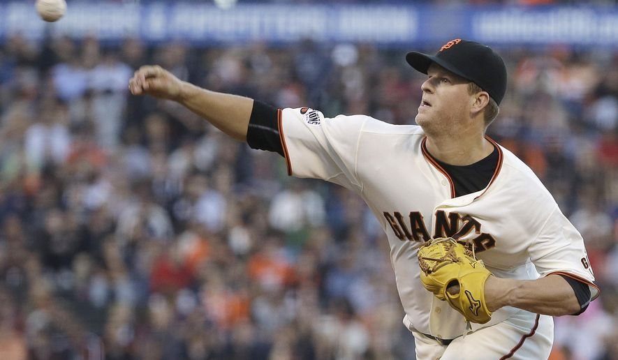 San Francisco Giants pitcher Matt Cain throws against the Milwaukee Brewers during the second inning of a baseball game in San Francisco, Tuesday, July 28, 2015. (AP Photo/Jeff Chiu)