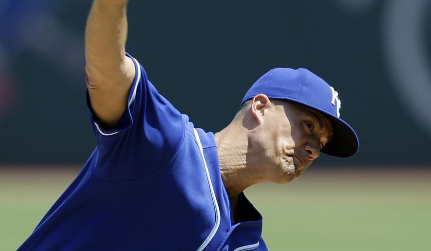 Kansas City Royals starting pitcher Jeremy Guthrie delivers in the first inning of a baseball game against the Cleveland Indians, Wednesday, July 29, 2015, in Cleveland. (AP Photo/Tony Dejak)