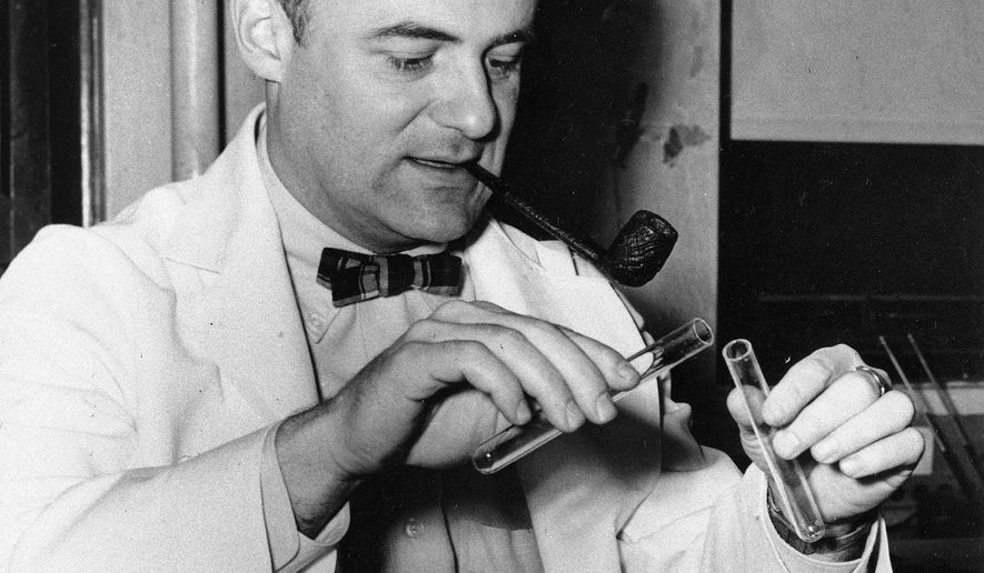 This Oct. 21, 1954 file photo shows Dr. Frederick C. Robbins, new chief of pediatrics and contagious diseases at Cleveland City Hospital, after the announcement that he, Dr. John Enders and Dr. Thomas Weller were awarded the Nobel prize for medicine. The 1954 Nobel Prize in medicine was awarded for work with fetal tissue that led to developing a vaccine against polio. (AP Photo/File)