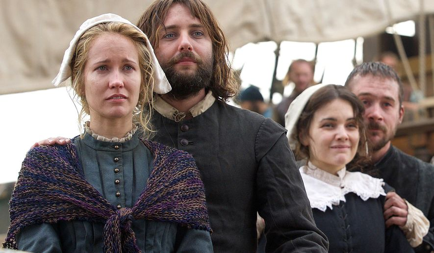 "This photo provided by National Geographic Channels shows, Anna Camp, from left, as Dorothy Bradford, William Kartheiser as William Bradford, Maria Vos as Elizabeth Winslow and Barry Sloane as Edward Winslow, onboard the Mayflower in National Geographic Channel's upcoming miniseries, ""Saints & Strangers,"" premiering in fall 2015. (David Bloomer/National Geographic Channels via AP)"