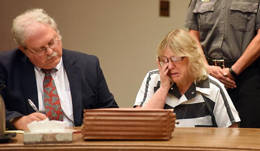 Joyce Mitchell cries as she sits with her attorney Stephen Johnston in court on Tuesday July 28, 2015 in Plattsburgh, N.Y.  Mitchell, an instructor in the tailor shop at the Clinton Correctional Facility, pleaded guilty to charges of aiding two inmates convicted of murder by smuggling hacksaw blades and other tools to the pair, who broke out and spent three weeks on the run in June. She faces a sentence of 2 1/3 to 7 years in prison under terms of a plea deal with prosecutors.  (Rob Fountain/The Press-Republican via AP, Pool)