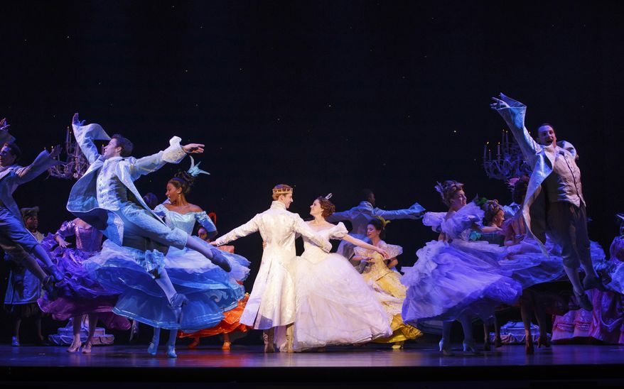 """In this undated image released by Boneau/Bryan-Brown, Andy Huntington, center left, and Paige Faure, center right, appear with the cast during a performance of the national tour of """"Rogers + Hammerstein's Cinderella"""" (Carol Rosegg/Boneau/Bryan-Brown via AP) ** FILE **"""