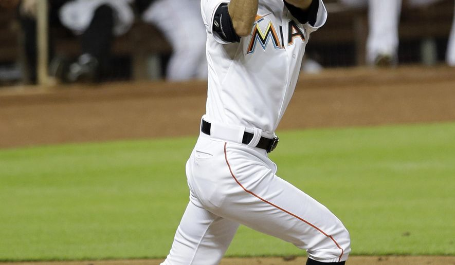 Miami Marlins' Ichiro Suzuki follows through on a double against the Miami Marlins in the second inning of a baseball game, Wednesday, July 29, 2015, in Miami. (AP Photo/Alan Diaz)