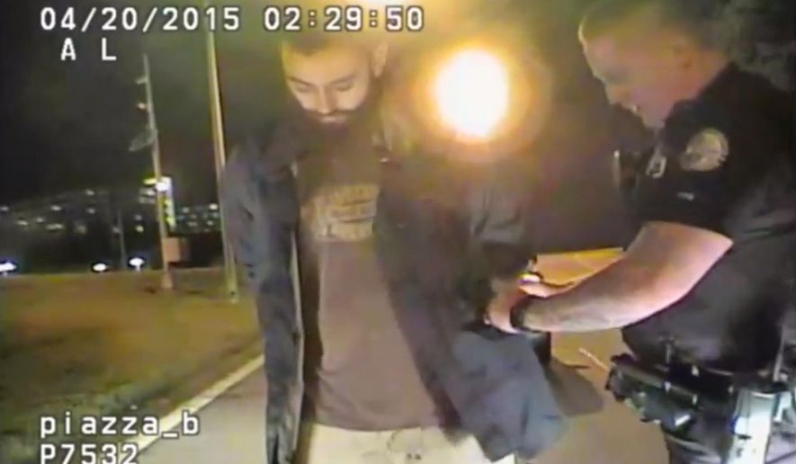 In this April 20, 2015 frame from dashcam video provided by the Chattanooga Police Department, Mohamad Youssef Abdulazeez is detained following roadside sobriety checks in Chattanooga, Tenn. On July 16, Abdulazeez opened fire on a recruiting office and then headed across town and blasted his way through a Navy-Marine reserve center. (Chattanooga Police Department via AP)