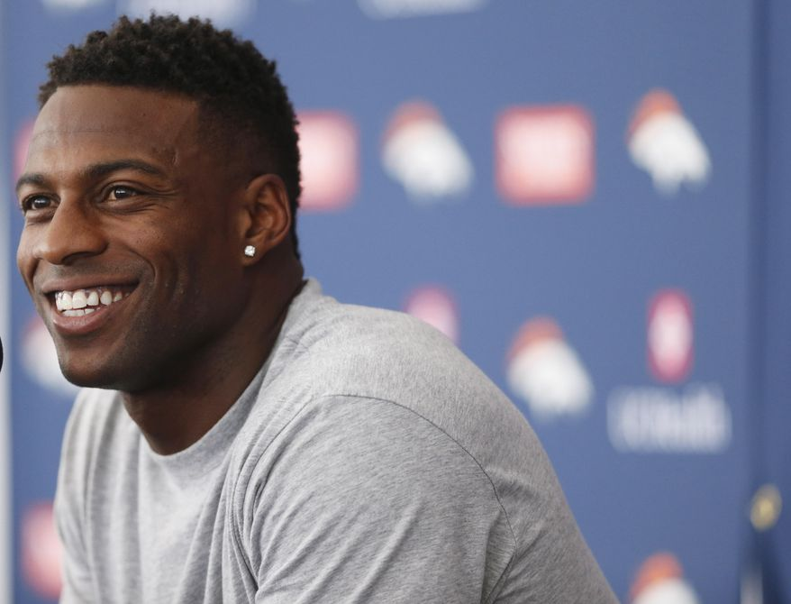 Denver Broncos wide receiver Emmanuel Sanders jokes with reporters during a news conference at the team's NFL football training camp Thursday, July 30, 2015, in Englewood, Colo. (AP Photo/David Zalubowski)