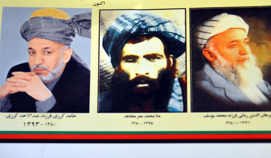 The death of Mullah Mohammad Omar (center) was confirmed by the Taliban, which postponed a second round of talks with Kabul. (Associated Press)