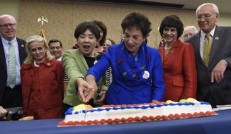 Rep. Doris Matsui, D-Calif, in green, and Rep. Jan Schakowsky, D-Ill., in blue, cut a cake to celebrate the 50th anniversary of Medicare and Medicaid on Capitol Hill in Washington on July 29, 2015. They are joined by Rep. Joe Crowley, D-N.Y., left, Rep. Debbie Dingell, D-Mich., second from left, Rep. Xavier Becerra, D-Calif., third from left, and Rep. Paul Tonko, D-N.Y., right.  (AP Photo/Susan Walsh)