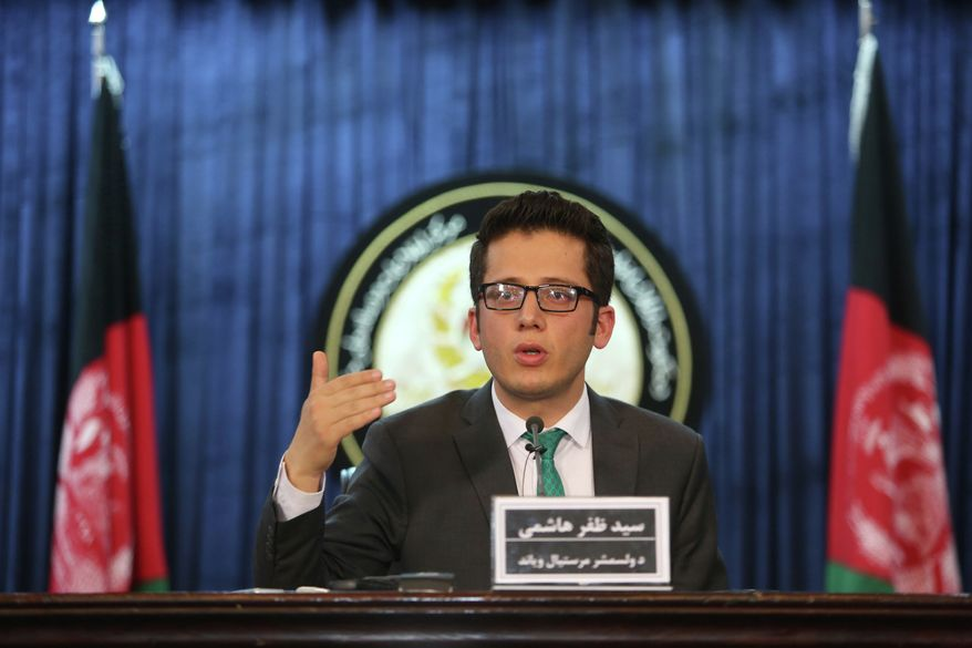 Zafar Hashemi, a deputy spokesman for Afghan President Ashraf Ghani, speaks during a press conference in Kabul, Afghanistan, on July 29, 2015. An Afghan official said Wednesday his government is examining claims that reclusive Taliban leader Mullah Omar is dead. (Associated Press)