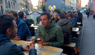 Beer is a basic of life in Copenhagen. Craft beers are all the rage on a street in Norrebro. (Photo by Lark Gould)