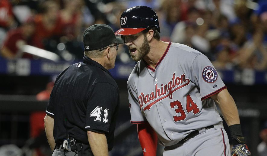Washington Nationals' Bryce Harper (34) argues with home plate umpire Jerry Meals (41) after striking out during the eleventh inning of a baseball game against the New York Mets, Friday, July 31, 2015, in New York. (AP Photo/Julie Jacobson)