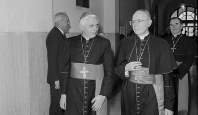 Cardinal William Wakefield Baum (left), former Archbishop of Washington, died July 23, 2015. In this March 21, 1987 photo, he and West German Cardinal Joseph Ratzinger arrived at the Vatican for a private lunch with Pope John Paul II. Cardinal Ratzinger became Pope Benedict XVI in 2005. (AP Photo/Gianni Foggia/File)