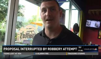 Nicholas Anderson was forced to put his carefully planned wedding proposal on hold and jump into action at a restaurant on Monday after a man busted in and tried to rob the place. (WCNC)