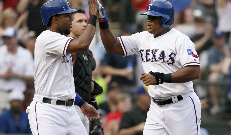 Texas Rangers' Elvis Andrus, left, congratulates Adrian Beltre, right, on his two run home run that scored Andrus in the first inning of a baseball game against the San Francisco Giants Friday, July 31, 2015, in Arlington, Texas. (AP Photo/Tony Gutierrez)