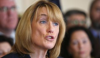 FILE - In this June 18, 2015 file photo, Democratic Gov. Maggie Hassan speaks at a news conference where she announced she would veto the Republican planned budget if changes are not made at the Statehouse. One month into the budget stalemate, Hassan and Republican lawmakers have begun talking, but a compromise may still be far away. In the meantime, the short-term spending plan is creating headaches for state agencies. (AP Photo/Jim Cole)