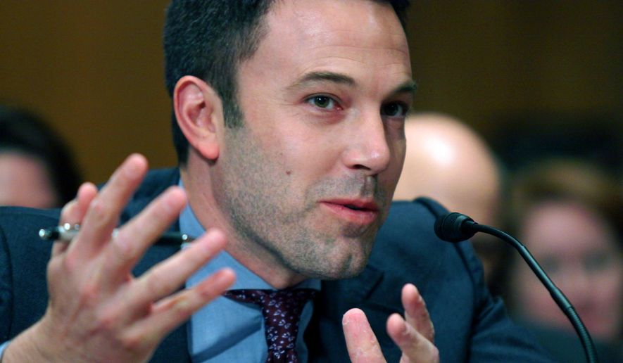 """FILE - In this March 26, 2015 file photo, actor Ben Affleck testifies on Capitol Hill in Washington  before the Senate State, Foreign Operations, and Related Programs subcommittee hearing on diplomacy, development and national. security. """"Finding Your Roots"""" will return for season three, but whether the celebrity genealogy series that buried an uncomfortable fact about Affleck's ancestor continues after that remains in doubt, PBS' chief executive said.(AP Photo/Lauren Victoria Burke)"""