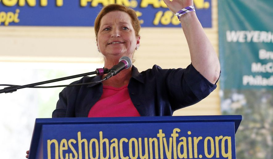 In this July 30, 2015 photograph, Vicki Slater, an attorney who has led the state trial lawyers' association, is one of three Democrats running in the primary for the party's nomination for governor, and is photographed speaking at the Neshoba County Fair in Philadelphia, Miss., Thursday, July 30, 2015. (AP Photo/Rogelio V. Solis)