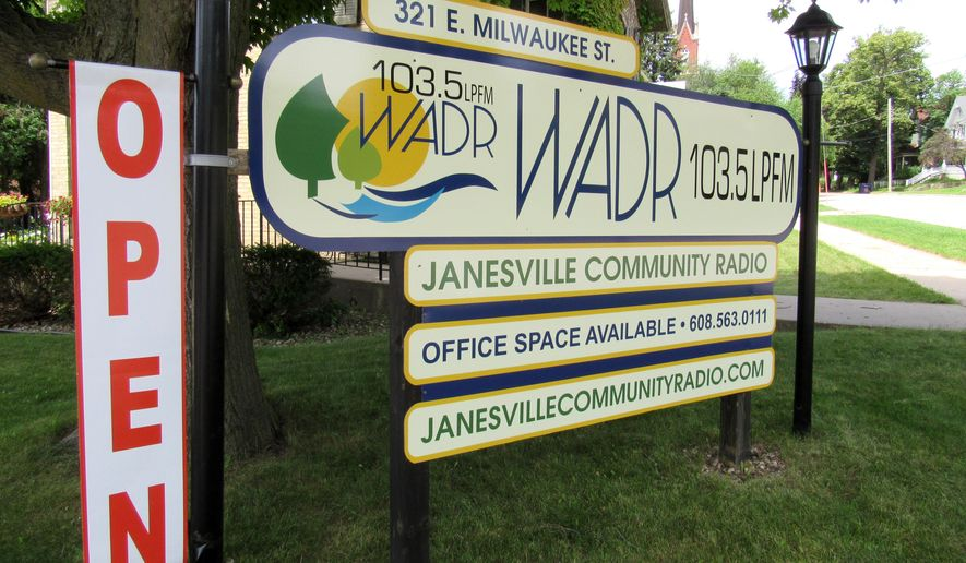 In this July 22, 2015 photo, a sign for WADR-FM in Janesville, Wis., is shown.  The radio is the latest low-powered radio station in Wisconsin to begin broadcasting. The station was formed by community members and unlike stations in Monona and Sun Prairie, is not operated by the city.  (Barry Adams/Wisconsin State Journal via AP) MANDATORY CREDIT
