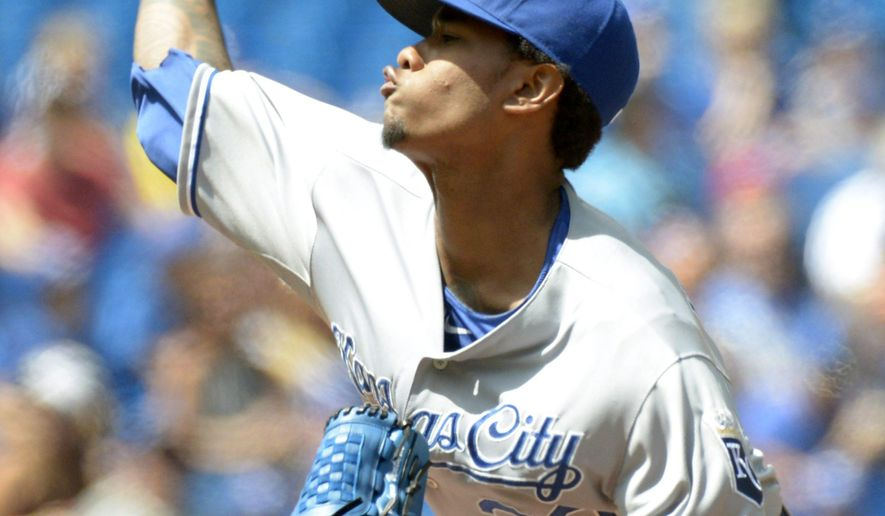 Kansas City Royals' Yordano Venture pitches against the Toronto Blue Jays during the first inning of a baseball game Saturday, Aug. 1, 2015, in Toronto. (Jon Blacker /The Canadian Press via AP) MANDATORY CREDIT