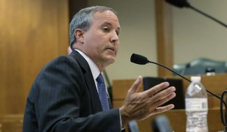 FILE - In this Wednesday, July 29, 2015 file photo, Texas Attorney General Ken Paxton speaks during a hearing in Austin, Texas. On Saturday, Aug. 1, 2015, Kent Schaffer, a special prosecutor, told the New York Times that Paxton has been indicted on felony charges that accuse the Republican of misleading investors before taking over as the state's top law enforcement officer. (AP Photo/Eric Gay)