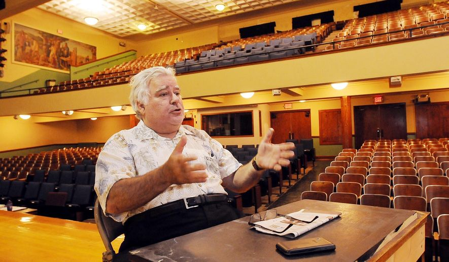 In this Monday, July 10, 2015 photo, Paul Warshauer, executive director of State Street Theater, discusses plans for the old middle school auditorium in New Ulm, Minn. The State Street Theater group plans to upgrade the facility and use it to put on plays and musicals. (John Cross/The Free Press via AP) MANDATORY CREDIT