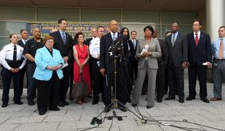 U.S. Rep. Elijah Cummings, front center, and other elected officials announce the start of the Baltimore Federal Homicide Task Force, Monday, Aug. 3, 2015, in Baltimore. Baltimore police and civic leaders launched a partnership Monday with five federal agencies that will embed their special agents with city homicide detectives, bidding to quell an upswing in homicides and other violent crime in that city. (Lloyd Fox/The Baltimore Sun via AP)