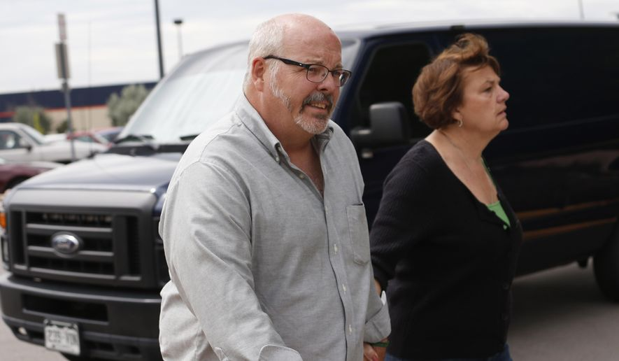 Tom Sullivan, front, who lost his son in the 2012 movie theater shooting in Aurora, Colo., heads to court to hear the reading in penalty phase 2 in the trial of  James Holmes Monday, Aug. 3, 2015, in Centennial, Colo. Jurors declined to rule out death for Holmes as they moved toward sentencing the Colorado theater shooter.(AP Photo/David Zalubowski)