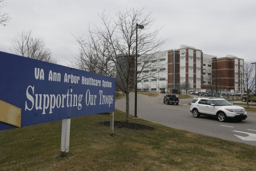 This April 3, 2015 photo shows the VA Ann Arbor Healthcare System in Ann Arbor, Mich. In an analysis of six months of appointment data at 940 VA hospitals and clinics nationwide from September 2014 to February 2015, at the VA hospital in Ann Arbor, an average of 3.4 percent of appointments took more than 30 days to complete between September and February, but that percentage was down to 2.4 percent in that last month. That's better than the national average of 2.8 percent. (AP Photo/Carlos Osorio)