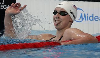 United State's Katie Ledecky reacts after setting a world record during her heat in the women's 1500m at the Swimming World Championships in Kazan, Russia, Monday, Aug. 3, 2015. (AP Photo/Michael Sohn)
