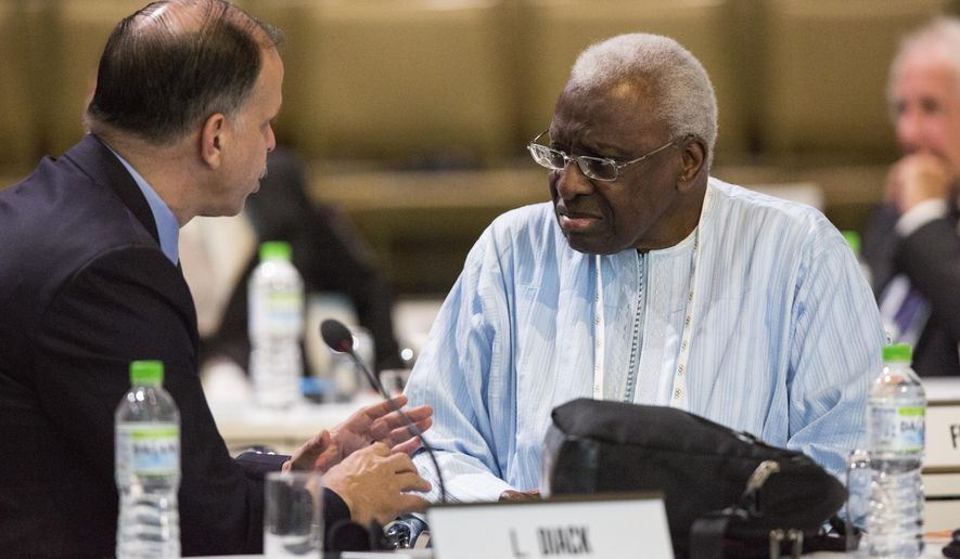 "International Association of Athletics Federations President Lamine Diack, right, speaks with a fellow International Olympic Committee member during the 128th IOC session in Kuala Lumpur, Malaysia Monday, Aug. 3, 2015. Three weeks before the world championships, athletics was thrown into turmoil by new accusations of widespread doping and experts denouncing an anti-doping system compromised by leniency. German broadcaster ARD and The Sunday Times newspaper in Britain said they obtained access to the results of 12,000 blood tests from 5,000 athletes. The files came from the database of the IAAF and were leaked by a whistleblower, according to the reports. The IAAF said it was aware of ""serious allegations made against the integrity and competence of its anti-doping program."" (AP Photo/Joshua Paul)"